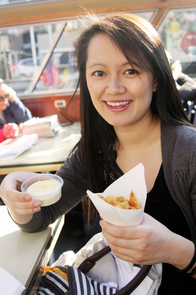 Ngoc Nguyen in Amsterdam eating fries